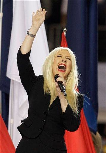 Christina Aguilera sings the national anthem before the NFL football Super Bowl XLV game between withe Green Bay Packers  and the Pittsburgh Steelers Sunday, Feb. 6, 2011, in Arlington, Texas. (AP Photo/Charlie Krupa) By Charlie Krupa