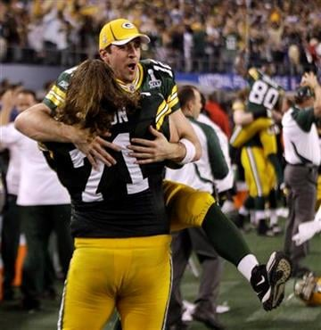 Green Bay Packers' Aaron Rodgers celebrates with teammate Josh Sitton (71) after beating the Pittsburgh Steelers 31-25 in the NFL football Super Bowl XLV game Sunday, Feb. 6, 2011, in Arlington, Texas. (AP Photo/David J. Phillip) By David J. Phillip