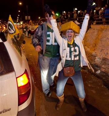 Green Bay Packers fans celebrate the Green Bay Packers 31-25 win in Super Bowl XLV   Sunday, Feb. 6, 2011, on Lombardi Avenue in front of  Lambeau Field in Green Bay, Wis.  (AP Photo/Mike Roemer) By Mike Roemer