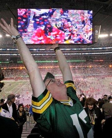 Green Bay Packers fan John Magnin celebrates after the NFL football Super Bowl XLV Sunday, Feb. 6, 2011, in Arlington, Texas. The Packers beat the Pittsburgh Steelers 31-25.(AP Photo/LM Otero) By LM Otero
