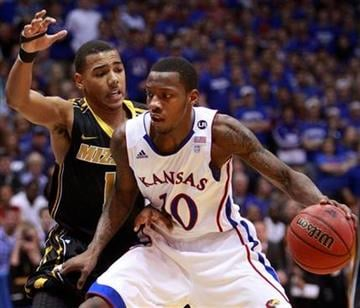 Kansas guard Tyshawn Taylor (10) works against Missouri guard Phil Pressey during the first half of an NCAA college basketball game in Lawrence, Kan., Monday, Feb. 7, 2011. (AP Photo/Orlin Wagner) By Orlin Wagner