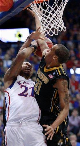 Kansas forward Markieff Morris, left, is fouled by Missouri forward Laurence Bowers during the first half of an NCAA college basketball game in Lawrence, Kan., Monday, Feb. 7, 2011. (AP Photo/Orlin Wagner) By Orlin Wagner