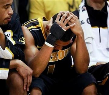 Missouri guard Phil Pressey holds his head after fouling out during the second half of an NCAA college basketball game against Kansas in Lawrence, Kan., Monday, Feb. 7, 2011. Kansas defeated Missouri 103-86. (AP Photo/Orlin Wagner) By Orlin Wagner