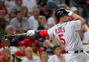 St. Louis Cardinals first baseman Albert Pujols (5) follows through with a solo home run during the fourth inning of a baseball game against the St. Louis Cardinals in Atlanta, on Thursday, Sept. 9, 2010. (AP Photo/John Bazemore) By John Bazemore