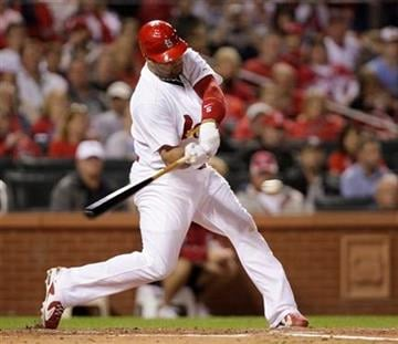 St. Louis Cardinals' Albert Pujols connects for an RBI single in the third inning of a baseball game against the Pittsburgh Pirates, Monday, Sept. 27, 2010, in St. Louis.(AP Photo/Tom Gannam) By Tom Gannam