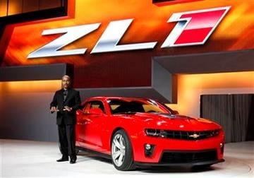 Ed Welburn, vice-president of Global Design with General Motors, unveils the new Chevrolet Camaro ZL1 at the Chicago Auto Show Wednesday, Feb. 9, 2011, in Chicago. (AP Photo/Charles Rex Arbogast) By Charles Rex Arbogast