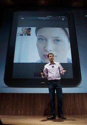 Palm CEO Jon Rubinstein, shows off the new TouchPad during a Palm/Hewlett Packard announcement in San Francisco, Wednesday, Feb. 9, 2011. (AP Photo) By KMOV Web Producer