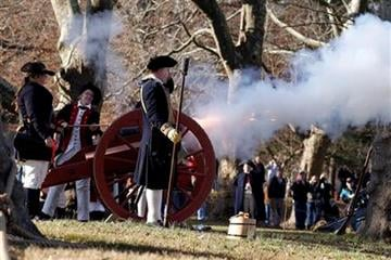 A six-pound cannon is fired during the 59th reenactment of Washington crossing the Delaware River Christmas Sunday, Dec. 25, 2011, in Washington Crossing, Pa. Over 168 re-enactors participated in the event. (AP Photo/Alex Brandon) By Alex Brandon