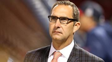 BOSTON, MA - OCTOBER 23:  General manager John Mozeliak on the field before Game One of the 2013 World Series against the Boston Red Sox at Fenway Park on October 23, 2013 in Boston, Massachusetts.  (Photo by Rob Carr/Getty Images) By Rob Carr