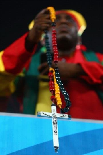 NATAL, BRAZIL - JUNE 16: A Ghana fan holds a rosary prior to the 2014 FIFA World Cup Brazil Group G match between Ghana and the United States at Estadio das Dunas on June 16, 2014 in Natal, Brazil.  (Photo by Michael Steele/Getty Images) By Michael Steele