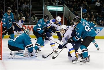 SAN JOSE, CA - JANUARY 03:  T.J. Oshie #74 of the St. Louis Blues scores a goal on Antti Niemi #31 of the San Jose Sharks in the first period at SAP Center on January 3, 2015 in San Jose, California.  (Photo by Ezra Shaw/Getty Images) By Ezra Shaw