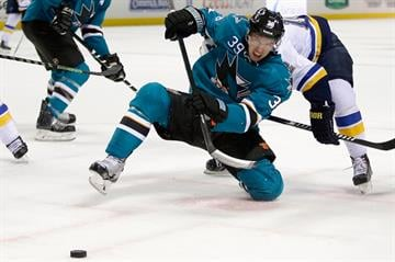 SAN JOSE, CA - JANUARY 03:  Logan Couture #39 of the San Jose Sharks wins a face off during their game against the St. Louis Blues at SAP Center on January 3, 2015 in San Jose, California.  (Photo by Ezra Shaw/Getty Images) By Ezra Shaw