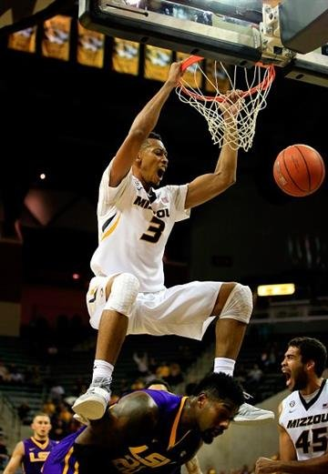COLUMBIA, MO - JANUARY 08:  Johnathan Williams III #3 of the Missouri Tigers dunks over Brian Bridgewater #20 of the LSU Tigers during the game at Mizzou Arena on January 8, 2015 in Columbia, Missouri.  (Photo by Jamie Squire/Getty Images) By Jamie Squire