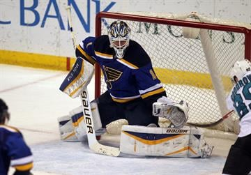 St. Louis Blues goaltender Brian Elliott makes a glove save in the third period against the San Jose Sharks at the Scottrade Center in St. Louis on January 8, 2015. St. Louis defeated San Jose 7-2.   Photo by Bill Greenblatt/UPI By BILL GREENBLATT