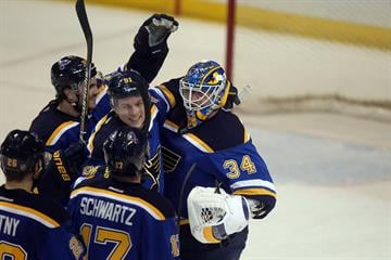 St. Louis Blues players mob goaltender Jake Allen after a 5-4 win in a shootout with the Carolina Hurricanes at the Scottrade Center in St. Louis on January 10, 2015.   Photo by Bill Greenblatt/UPI By BILL GREENBLATT