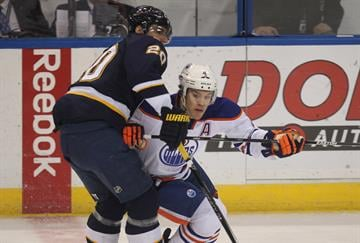 St. Louis Blues Alexander Steen holds back Edmonton Oilers Taylor Hall in the first period at the Scottrade Center in St. Louis on January 13, 2015.    Photo by Bill Greenblatt/UPI By BILL GREENBLATT