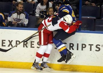 Detroit Red Wings Danny DeKeyser puts his shoulder into St. Louis Blues David Backes in the first period at the Scottrade Center in St. Louis on January 15, 2015. Photo by Bill Greenblatt/UPI By BILL GREENBLATT
