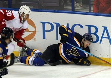 Detroit Red Wings Stephen Weiss (90) takes down St. Louis Blues Carl Gunnarsson in the first period at the Scottrade Center in St. Louis on January 15, 2015. Photo by Bill Greenblatt/UPI By BILL GREENBLATT