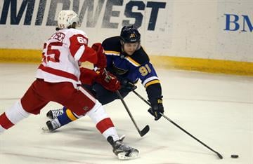 St. Louis Blues Vladimir Tarasenko of Russia loses the puck after being checked by Detroit Red Wings Danny DeKeyser in the first period at the Scottrade Center in St. Louis on January 15, 2015. Photo by Bill Greenblatt/UPI By BILL GREENBLATT