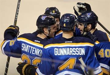 St. Louis Blues Kevin Shattenkirk (L) is congratulated after scoring a goal against the Toronto Maple Leafs in the first period at the Scottrade Center in St. Louis on Janaury 17, 2015.    Photo by Bill Greenblatt/UPI By BILL GREENBLATT
