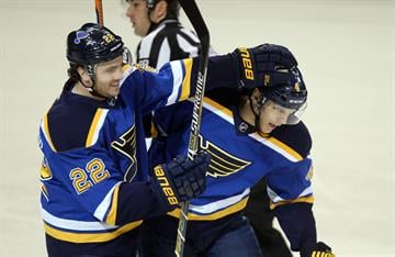 St. Louis Blues Kevin Shattenkirk (L) congratulates Carl Gunnarsson of Sweden after his first period goal against the Colorado Avalanche at the Scottrade Center in St. Louis on January 19, 2015. Photo by Bill Greenblatt/UPI By BILL GREENBLATT