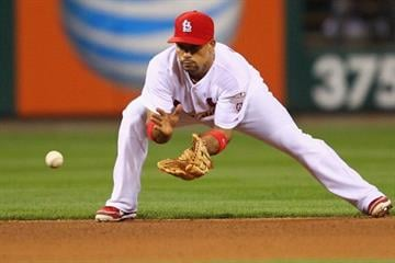 ST. LOUIS, MO - JUNE 13: Rafael Furcal #15 of the St. Louis Cardinals fields a ground ball against the Chicago White Sox at Busch Stadium on June 13, 2012 in St. Louis, Missouri.  (Photo by Dilip Vishwanat/Getty Images) By Dilip Vishwanat