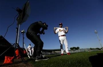St. Louis Cardinals third baseman David Freese, right, poses for photographer Chris Trotman during the team's photo day at spring training baseball, Tuesday, Feb. 19, 2013, in Jupiter, Fla. (AP Photo/Julio Cortez) By Julio Cortez