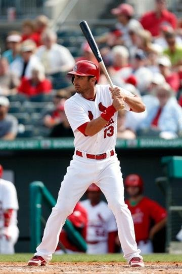 JUPITER, FL - FEBRUARY 28: Matt Carpenter #13 of the St. Louis Cardinals at bat against the Miami Marlins at the Roger Dean Stadium on February 28, 2013 in Jupiter, Florida.  (Photo by Chris Trotman/Getty Images) By Chris Trotman