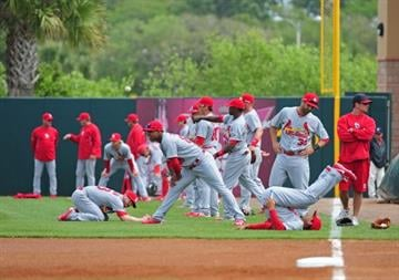 KISSIMMEE, FL - MARCH 1: Members of the St. Louis Cardinals warm up before a spring training game against the Houston Astros at Osceola County Stadium on March 1, 2013 in Kissimmee, Florida. (Photo by Scott Cunningham/Getty Images) By Scott Cunningham