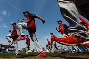 PORT ST. LUCIE, FL - FEBRUARY 27: Members of the St. Louis Cardinals warm up prior to the game against the New York Mets at Tradition Field on February 27, 2013 in Port St. Lucie, Florida.  (Photo by Chris Trotman/Getty Images) By Chris Trotman