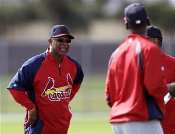 St. Louis Cardinals visiting coach Ozzie Smith, left, talks to visiting coach Willie McGee, right, at spring training baseball, Tuesday, Feb. 19, 2013, in Jupiter, Fla. (AP Photo/Julio Cortez) By Julio Cortez
