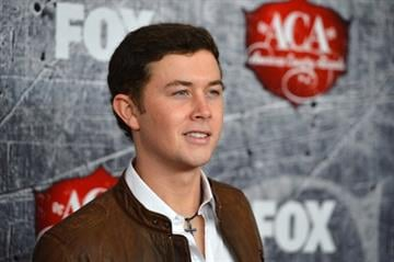 LAS VEGAS, NV - DECEMBER 10:  Singer Scotty McCreery arrives at the 2012 American Country Awards at the Mandalay Bay Events Center on December 10, 2012 in Las Vegas, Nevada.  (Photo by Frazer Harrison/Getty Images) By Frazer Harrison