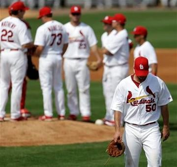 St. Louis Cardinals starting pitcher Adam Wainwright leavs the game in the third inning of an exhibition spring training baseball game against the Houston Astros in Jupiter, Fla., Monday, Feb. 25, 2013. (AP Photo/Julio Cortez) By Julio Cortez
