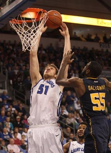 Saint Louis Billikens Rob Loe dunks the basketball in front of LaSalle Explorers Ramon Galloway in the first half at the Chaifetz Arena in St. Louis on March 9, 2013.    UPI/Bill Greenblatt By BILL GREENBLATT
