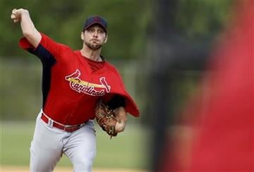 St. Louis Cardinals starting pitcher Adam Wainwright throws a live batting practice session during spring training baseball, Tuesday, Feb. 19, 2013, in Jupiter, Fla. (AP Photo/Julio Cortez) By Julio Cortez