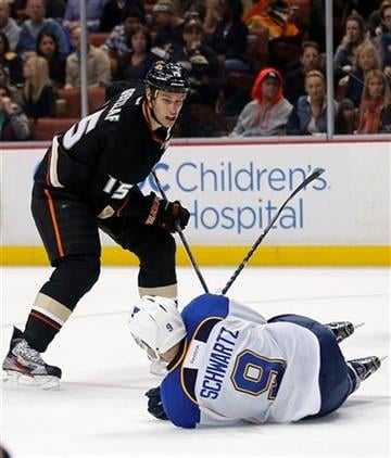 St. Louis Blues' Jaden Schwartz (9) falls to the ice as Anaheim Ducks' Ryan Getzlaf watches during the second period of an NHL hockey game in Anaheim, Calif., Sunday, March 10, 2013. (AP Photo/Jae C. Hong) By Jae C. Hong