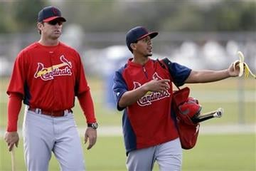 St. Louis Cardinals center fielder Jon Jay, right, talks to manager Mike Matheny during spring training baseball, Tuesday, Feb. 19, 2013, in Jupiter, Fla. (AP Photo/Julio Cortez) By Julio Cortez