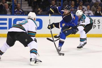 ST. LOUIS, MO - MARCH 12: Kris Russell #4 of the St. Louis Blues takes a shot on goal against the San Jose Sharks at the Scottrade Center on March 12, 2013 in St. Louis, Missouri.  (Photo by Dilip Vishwanat/Getty Images) By Dilip Vishwanat