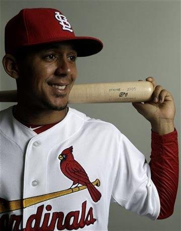 St. Louis Cardinals center fielder Jon Jay holds a bat while posing during the team's photo day at spring training baseball, Tuesday, Feb. 19, 2013 in Jupiter, Fla. (AP Photo/Julio Cortez) By Julio Cortez