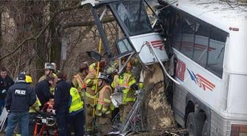 Emergency and rescue crews respond to the scene of a tour bus crash on the Pennsylvania Turnpike March 16, 2013, near Carlisle, Pa. / AP Photo/The Sentinel - Jason Malmont By Dan Mueller