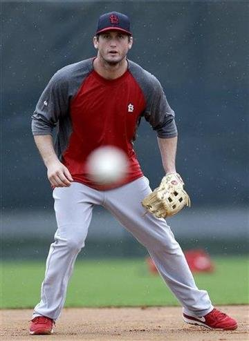 St. Louis Cardinals third baseman David Freese fields a ground ball during the team's first full squad workout at spring training baseball, Friday, Feb. 15, 2013, in Jupiter, Fla. (AP Photo/Julio Cortez) By Julio Cortez