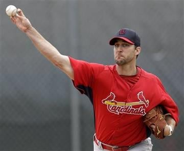 St. Louis Cardinals starting pitcher Adam Wainwright throws a bullpen session during the team's first full squad workout at spring training baseball, Friday, Feb. 15, 2013, in Jupiter, Fla. (AP Photo/Julio Cortez) By Julio Cortez