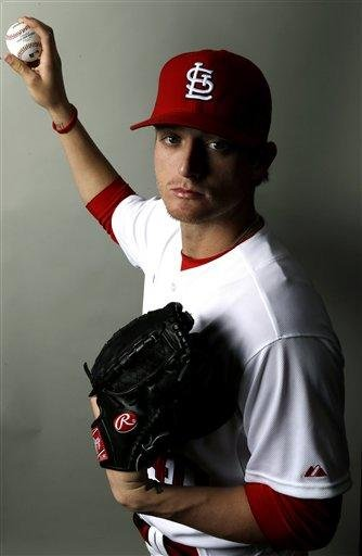 St. Louis Cardinals prospect Shelby Miller holds a baseball while posing during the team's photo day at spring training baseball, Tuesday, Feb. 19, 2013 in Jupiter, Fla. . (AP Photo/Julio Cortez) By Julio Cortez