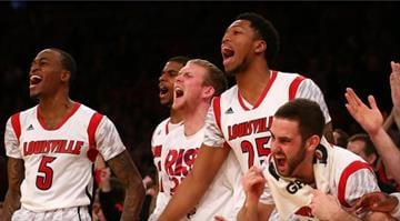 Louisville Cardinals players celebrate on the bench against the Syracuse Orange during the final of the Big East Men's Basketball Tournament at Madison Square Garden on March 16, 2013, in New York City. / Elsa/Getty Images By Dan Mueller