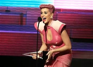 Katy Perry accepts the special award for five number one singles from one album at the 39th Annual American Music Awards on Sunday, Nov. 20, 2011 in Los Angeles. (AP Photo/Matt Sayles) By Matt Sayles