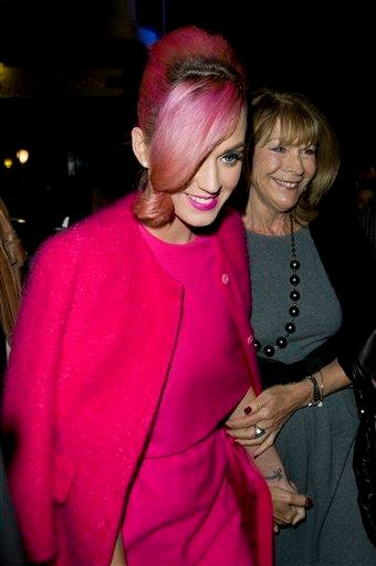 U.S. singer Katy Perry, left, arrives at a central London Theatre, Monday, Oct. 17, 2011. (AP Photo/Jonathan Short) By Jonathan Short