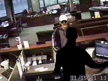 "This surveillance photo from Bandit Tracker shows a man officials have dubbed the ""logo bandit."" He is accused of robbing five area banks between September and December 2011. By KMOV Web Producer"
