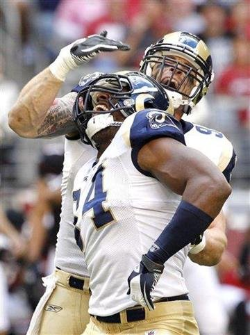 St. Louis Rams' Robert Quinn, front, celebrates his sack of Arizona Cardinals' John Skelton with teammate Chris Long during the second quarter of an NFL football game Sunday, Nov. 6, 2011, in Glendale, Ariz. (AP Photo/Ross D. Franklin) By Ross D. Franklin