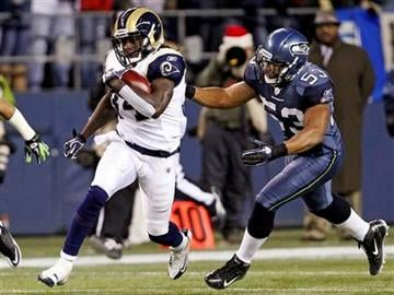 St. Louis Rams' Jerious Norwood, left, returns a kickoff as Seattle Seahawks' Malcolm Smith moves in for the tackle in the first half of an NFL football game, Monday, Dec. 12, 2011, in Seattle. (AP Photo/Elaine Thompson) By Elaine Thompson