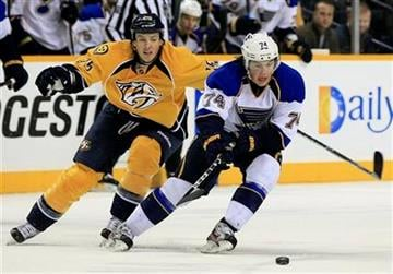 St. Louis Blues center T. J. Oshie (74) is defended by Nashville Predators center Jerred Smithson (25) in the second period of an NHL hockey game on Saturday, Dec. 17, 2011, in Nashville, Tenn. (AP Photo/Mark Humphrey) By Mark Humphrey